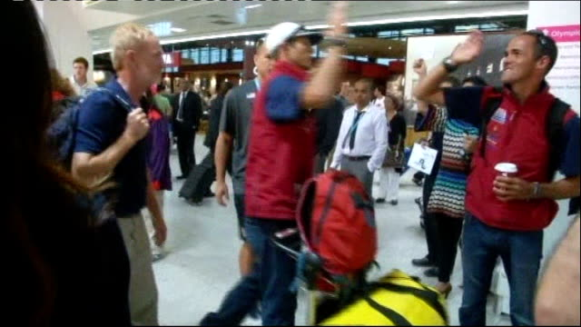 confusion over olympic lanes / athlete bus gets lost england londn heathrow airport int various shots of usa olympic sailing team members through... - 2012年ロンドン夏季オリンピック点の映像素材/bロール
