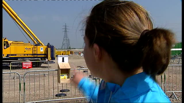 london 2012 olympic games: construction begins on london's olympic stadium; goldie sayers interview sot - talks of where javelin run-up will be and... - javelin stock videos & royalty-free footage
