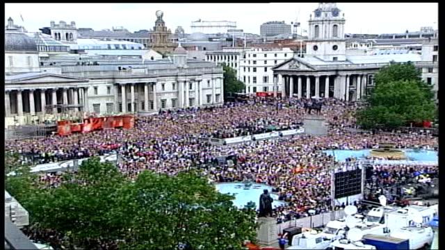 london 2012 olympic games: cost of games; tx 1.9.2005 trafalgar square: crowds celebrating winning 2012 olympic bid - bid stock videos & royalty-free footage