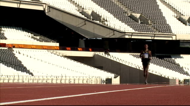 london 2012 olympic games: cost of tickets in olympic stadium revealed; england: london: olympic park: olympic stadium: ext mo farah kneeling down... - fototermin stock-videos und b-roll-filmmaterial