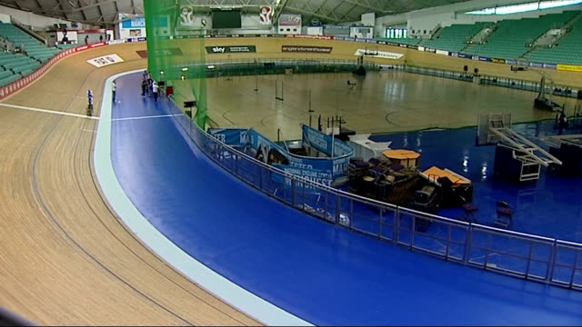 london 2012 olympic games: cycling: test event to take place at velodrome; 10.2.2012 manchester: int interior of national cycling centre cyclists... - commonwealth games stock videos & royalty-free footage