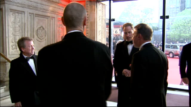 london 2012 olympic games: duke and duchess of cambridge attend gala dinner; england: london: royal albert hall: ext gvs royal car arrives on red... - jenny davies stock videos & royalty-free footage