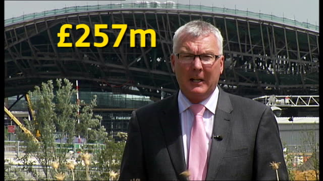 emergency budget results in funding crisis reporter to camera as various figures overlaid david higgins interview sot more general views of main... - ロンドン オリンピックパーク点の映像素材/bロール