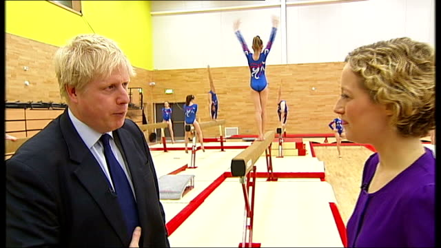 london 2012 olympic games: europa gym centre unveiled; boris johnson interview sot - reporter jokes with him about gym facilities at eton school - channel 4 news stock videos & royalty-free footage