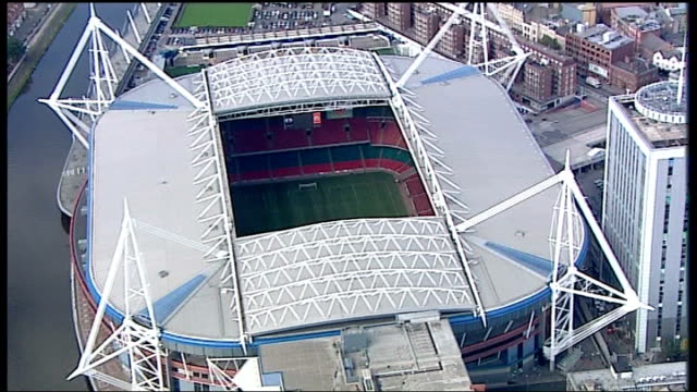 london 2012 olympic games: first event to be held in cardiff; wales: cardiff: ext air views / aerials of millennium stadium gvs of millennium stadium... - in front of点の映像素材/bロール