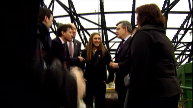 gordon brown visit to olympic park site brown chatting to armitt dobriskey tessa jowell mp lord coe andy burnham mp and unidentified official / brown... - ゴードン ブラウン点の映像素材/bロール