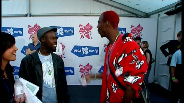 london 2012 olympic games handover concert on the mall: celebrity interviews backstage; phillips idowu interview sot - on what the crowd are like,... - zweiter platz stock-videos und b-roll-filmmaterial
