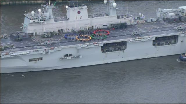 hms ocean deployed as part of olympics security england london hms ocean along river thames with crew members forming olympic rings on flight deck... - olympic rings stock videos & royalty-free footage