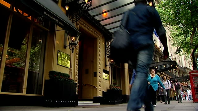 london 2012 olympic games: hotel and ticket package deals; low angle shot entrance to waldorf hotel close shot 'waldorf' sign above entrance - ウォルドルフ・アストリア点の映像素材/bロール