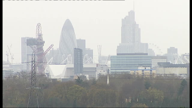 london 2012 olympic games: ilford becomes favoured destination; england: london: ilford: int hotel bed hotel window ext olympic village skyline high... - ilford stock videos & royalty-free footage