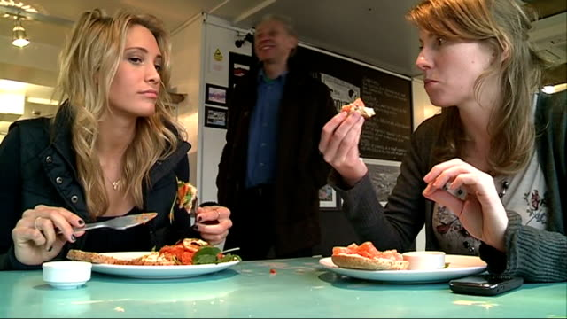 stockvideo's en b-roll-footage met london 2012 olympic games: 'inside track': athletes' diet and training regime; int tasha danvers interview sot cutaway two women athletes sitting in... - atlete