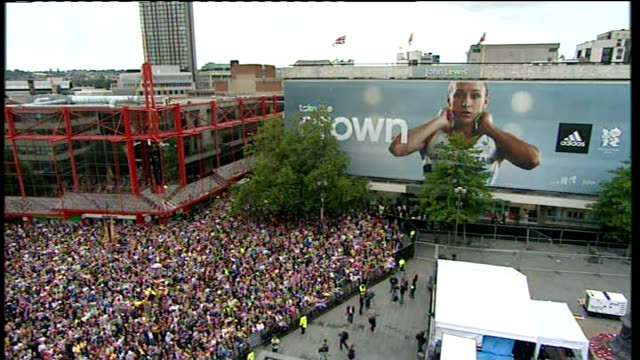 london 2012 olympic games: jessica ennis returns home to sheffield; gv large hoarding featuring jess ennis pull out to crowd gathered gv crowd... - sheffield stock videos & royalty-free footage