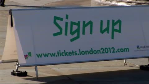 vidéos et rushes de london 2012 olympic games: launch of ticketing arrangements in trafalgar square; england: london: trafalgar square: ext wide shot of promotional... - adrian chiles