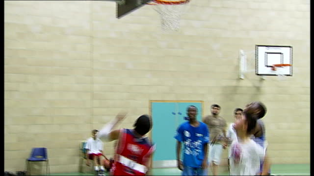 london 2012 olympic games: legacy debate; england: essex: ilford: frenford sports club: int young men playing basketball in gymnasium vox pops - ilford stock videos & royalty-free footage