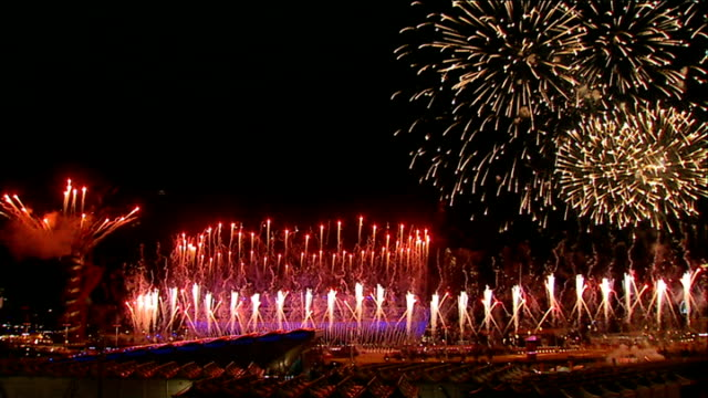 london 2012 olympic games legacy one year on business investment r28071202 / london 2012 olympic games opening ceremony with fireworks over olympic... - 2012年ロンドン夏季オリンピック点の映像素材/bロール