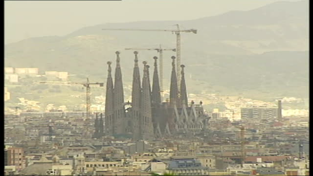 lord coe looks to longterm benefits barcelona skyline with spires of la sagrada familia towering over surrounding buildings barcelona skyline with... - guglia video stock e b–roll