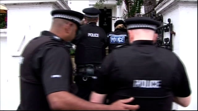 Man charged after streaking during Olympic Torch Relay ENGLAND Oxfordshire Henley upon Thames EXT Daniel Leer being escorted along by police officers...