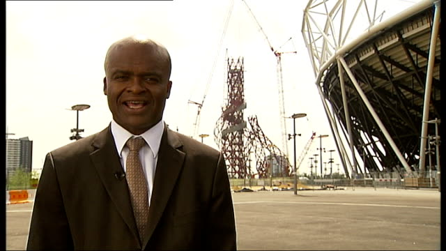 london 2012 olympic games: medals hopes for british athletes; england: london: ext reporter to camera outside velodrome - kriss akabusi stock videos & royalty-free footage