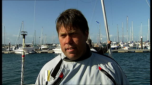 london 2012 olympic games: medals hopes for british athletes; tx 9.6.2011 dorset: weymouth: andrew simpson during interview on boat with graphic... - kriss akabusi stock videos & royalty-free footage