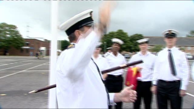 london 2012 olympic games military personnel practise raising flags england hampshire fareham hms collingwood ext gvs sailors folding flags / walk /... - hoisting stock videos & royalty-free footage