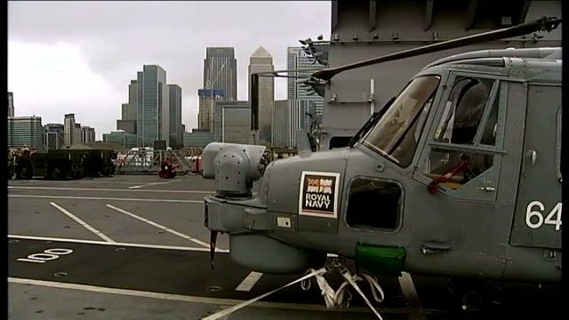 military security exercises begin on various shots of royal navy lynx helicopters parked on flight deck close shot crew member wearing safety helmet... - skibrille stock-videos und b-roll-filmmaterial