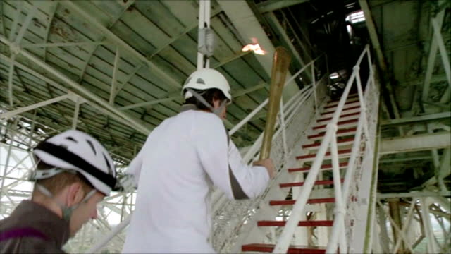 london 2012 olympic games: olympic torch relay: comedian john bishop carries flame to jodrell bank; england: cheshire: ext sequence comedian john... - 2012 stock videos & royalty-free footage