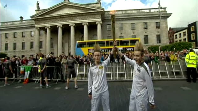 London 2012 Olympic Games Olympic Torch relay Jedward take part REPUBLIC OF IRELAND Dublin EXT Jedward carrying London 2012 Olympic torch past...