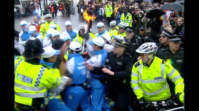 olympic torch relay metropolitan police unit providing security r06040802 television presenter konnie huq being attacked by protestor as... - olympic torch stock videos & royalty-free footage