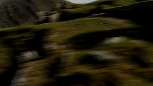 london 2012 olympic games: olympic torch relay: sir chris bonington takes flame to top of mount snowdon; people seen walking up mount snowdon int... - flaming torch stock videos & royalty-free footage