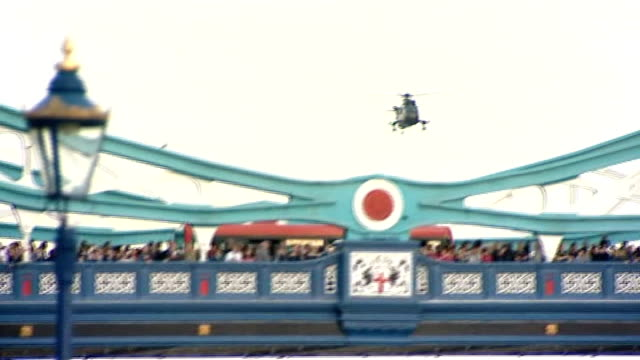 london 2012 olympic games: olympic torch relay: tower of london; england: london: tower bridge: ext various shots of raf helicopter over tower bridge... - flaming torch stock videos & royalty-free footage