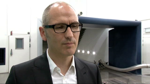 Olympic torch tested in Munich Huber interview SOT On how torch was tested under various conditions CUTAWAYs water dropping on floor / close shot...