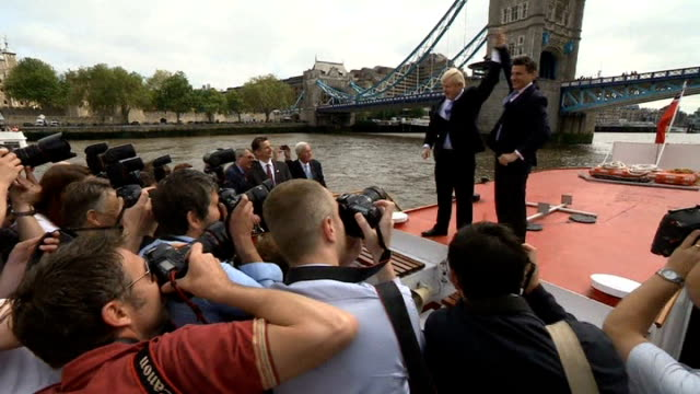 one month to go olympic rings suspended from tower bridge johnson and coe holding hands up in front of press - tower bridge stock videos & royalty-free footage