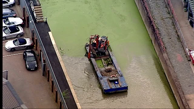 One year to go Air views of Olympic Park AIR VIEW / AERIALS of earth mover with bucket mounted on barge and clearing algae from river / AIR VIEWS of...