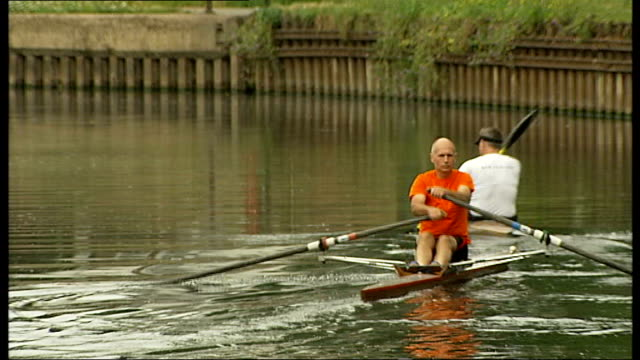 organisers launch search for volunteers to clean london waterways t06081119 tottenham jogger and cyclist along on towpath rowers rowing on river... - rowing stock videos & royalty-free footage