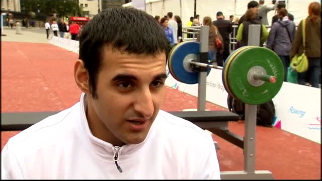 Paralympics International Paralympic Day Ali Jawad lifting weights then doing headstand on bench as audience applauds SOT Ali Jawad interview SOT...