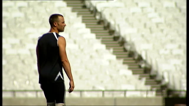 paralympics interview with paralympic runner oscar pistorius england london ext various views of the 2012 olympic games stadium pan / various views... - オスカー・ピストリウス点の映像素材/bロール