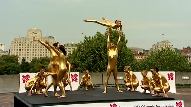 plans announced for olympic flame torch relay press event and photocalls england london south bank ext group of male and female gymnasts performing... - human pyramid stock videos and b-roll footage