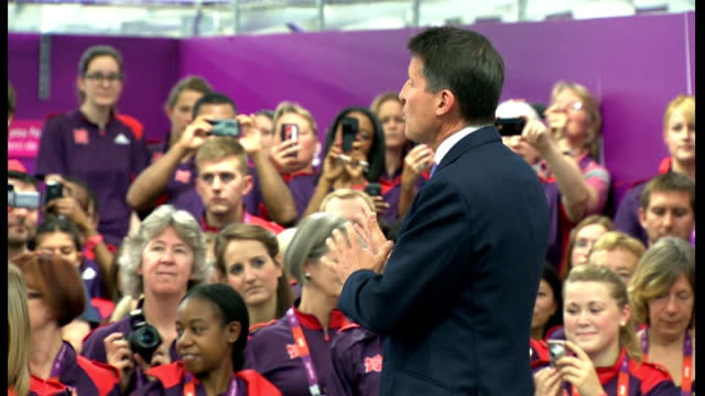 vídeos de stock, filmes e b-roll de protests david cameron meeting olympic volunteers and heckled games makers applauding arriving of lord coe on stage sot david cameron mp onto stage... - stage make up