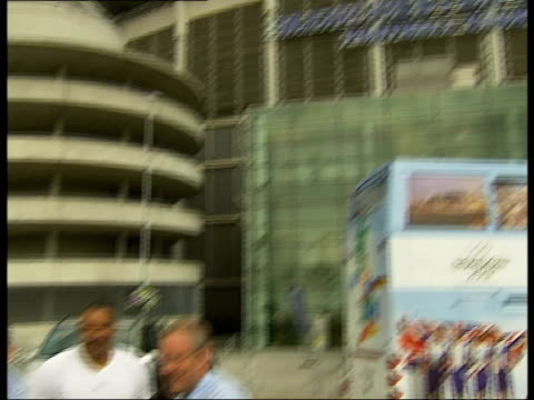 roadshow in manchester caborn thompson and coe posing for photocall in front of stadium building including pan to low angle view of stadium / tour... - olympic rings stock videos & royalty-free footage