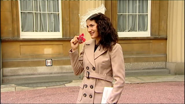Sarah Stevenson preparations R22021210 Buckingham Palace EXT Sarah Stevenson with her MBE BV Sarah walking away on crutches