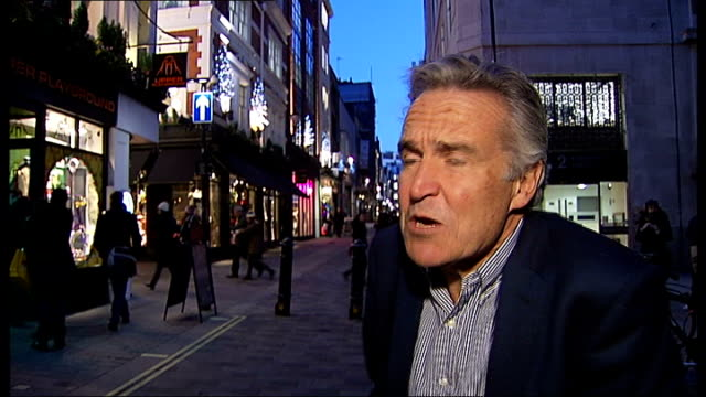 Security measures to be doubled London Stephen Bayley inteview SOT NIGHT Ends Stratford 'Welconme to London 2012 Olympic Park' sign with security...