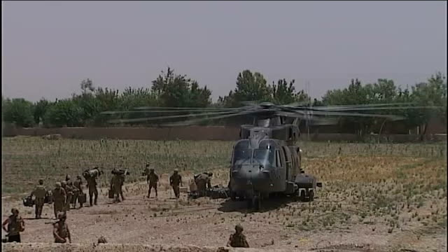 thirteen and a half thousand military personnel to provide security tx nahresaraj district british soldier at open hatch of helicopter as flying over... - helicopter rotors stock videos and b-roll footage