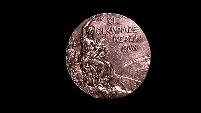 london 2012 olympic games: tickets for former british olympians; close shot of dorothy's olympic silver medal from 1936 olympic games - zweiter platz stock-videos und b-roll-filmmaterial