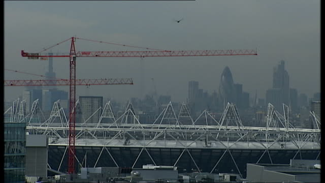 tickets to go on sale on 15 march 2011 england london stratford olympic park general view of city of london skyline with olympic stadium in the... - lowering stock videos & royalty-free footage