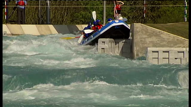 white water rafting course opens general views raft along down rapids crashing into waves / whitewater crew paddling past zoom in crashing waves and... - whitewater rafting stock videos & royalty-free footage