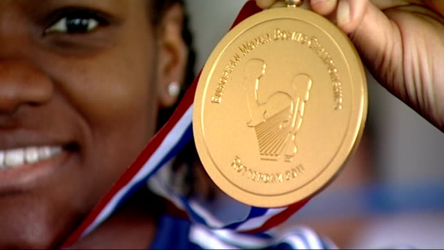 london 2012 olympic games: women's boxing to make olympic debut in london; november 2011 england: west yorkshire: bradford: close shot of adams... - boxing women's stock videos & royalty-free footage