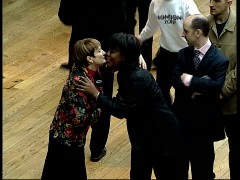 london 2012 olympics bid launched; itn england: london: covent garden: royal opera house: int tgv crowd of schoolchildren waving as launching... - bid stock videos & royalty-free footage