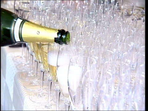 london 2012 olympics bid launched; itn int waiter pouring champagne - bid stock videos & royalty-free footage