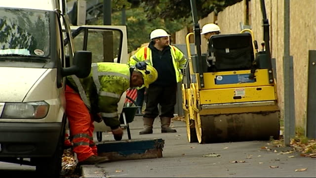 site construction delayed as travellers wait to be rehoused workmen by van with toolbox and road roller - toolbox stock videos and b-roll footage
