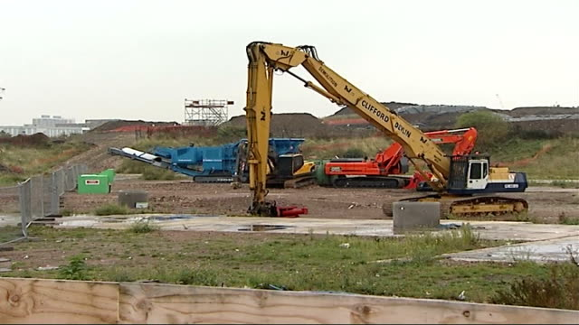 site construction delayed as travellers wait to be rehoused excavator and other demolition vehicles on olympic site orange 'concrete cruncher' vehicle - construction vehicle stock videos & royalty-free footage